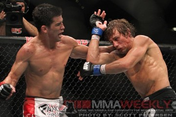 Dominick Cruz (l) and Urijah Faber battle at UFC 132 (Scott Petersen/MMA Weekly)