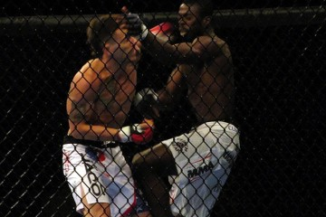 Brandon Thatch (L) delivers a left hook (Rob Tatum/The MMA Corner)