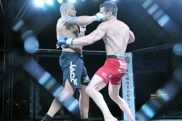 Chris Holland (L) delivers a right hand against Josh Cavan (Phil Lamber/The MMA Corner)