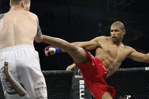 Bryan Baker (R) throws a kick (Sherdog)