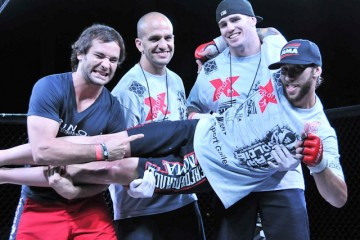 Chase Hackett (horizontal) celebrates with his coaches (Phil Lambert/The MMA Corner)