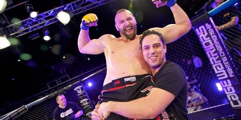 Andreas Kraniotakes celebrates victory (Cage Warriors)