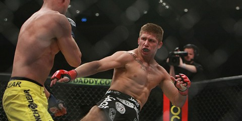Justin Lawrence (R) throws a kick (Sherdog)