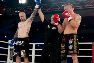 Mark Miller (L) has his hand raised victory (Glory World Series)