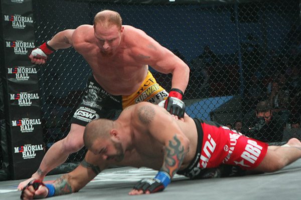 Eric Prindle (L) works for the finish (Sherdog)
