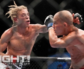 Jonathan Brookins (L) delivers a left hand (Paul Thatcher/Fight! Magazine)