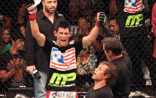 Dominick Cruz (L) celebrates his UFC 132 win over Urijah Faber (Rob Tatum/The MMA Corner)