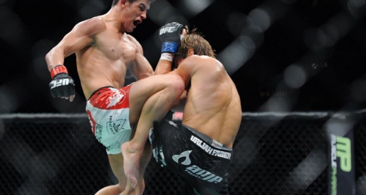 Dominick Cruz (L) delivers a knee against Urijah Faber (Heavy MMA)