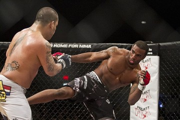 Gerald Harris (R) throws a kick (Andy Hemingway/Sherdog)