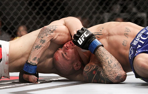 Chan Sung Jung (L) chokes out Dustin Poirier (Tracy Lee/Yahoo! Sports)
