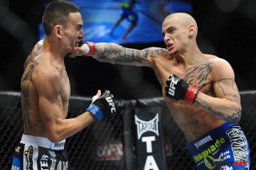 Dustin Poirier (R) delivers a right hand (James Law/Heavy MMA)