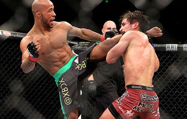 Demetrious Johnson (L) kicks Ian McCall (Tracy Lee/Yahoo! Sports)