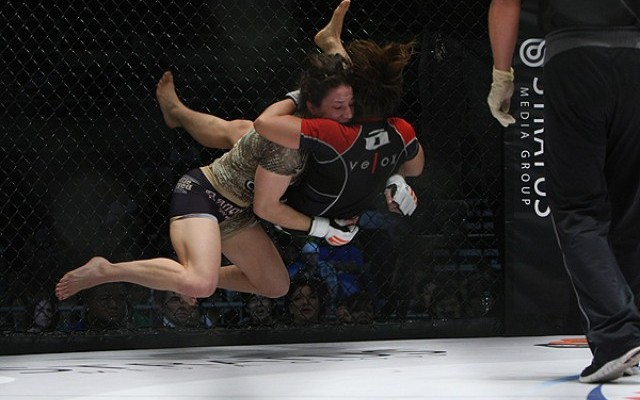 McMann (camo top) scored with a takedown (Dave Mandel/Sherdog)