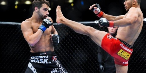 Ivan Menjivar (R) battles Nick Pace at UFC 133 (Jeremy Botter/Heavy MMA)
