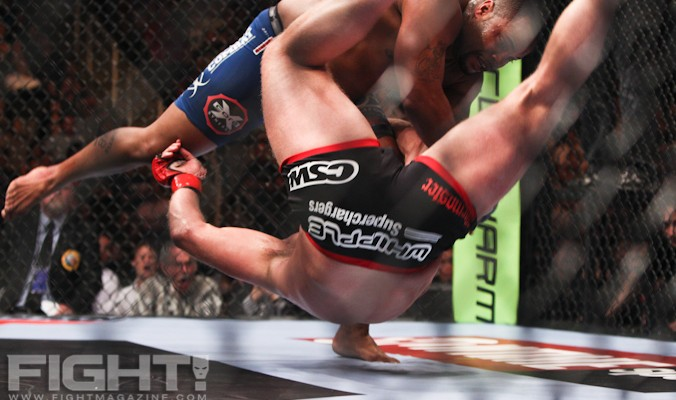 Daniel Cormier (top) slams Josh Barnett to the canvas (Paul Thatcher/Fight! Magazine)