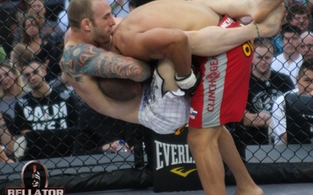 Luke Zachrich (white trunks) attempts a submission against Eric Schambari (Bellator Fighting Championships)