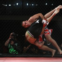 Ulysses Gomez (red and white shorts) scores with a takedown (Dave Mandel/Sherdog)