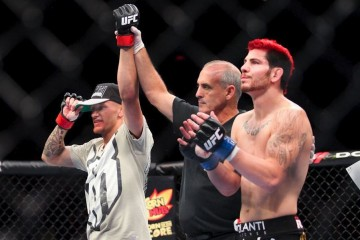 Dustin Pague (L) has his hand raised in victory (Heavy MMA)