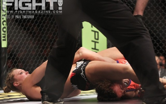 Rousey (L) forces Miesha Tate to submit (Paul Thatcher/Fight! Magazine)