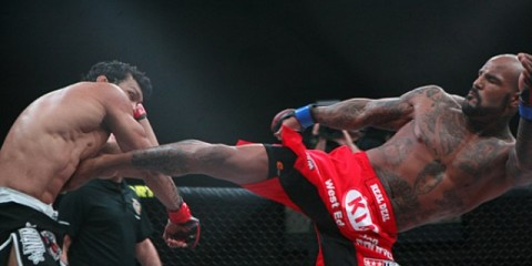 Ryan Ford (R) connects with a kick (Keith Mills/Sherdog)