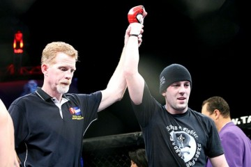 Tyler Toner (R) has his hand raised in victory (Isaac Hinds/Sherdog)
