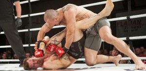 Mutapcic (top) battles Jacen Flynn at MFC 34 (Maximum Fighting Championship)