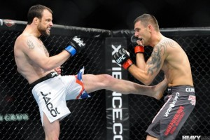 Jeff Hougland (L) connects with a kick in his UFC debut (Heavy MMA)