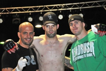Adam Stroup (center) after a win (Factory X Muay Thai)