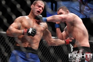 Junior dos Santos (L) and Cain Velasquez engage in a striking war at UFC 155 (Paul Thatcher/Fight! Magazine)
