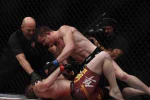 C.B. Dollaway (top) (Esther Lin/MMA Fighting)