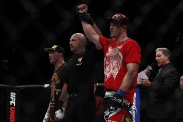 Dollaway has him arm raised in victory (Esther Lin/MMA Fighting)