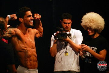 Thiago Tavares (L) weighs in while Khabib Nurmagomedov looks on  (Aline Baktchejian Djehdian/The MMA Corner)