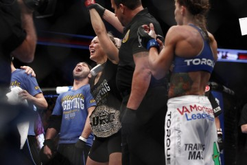 Ronda Rousey has her hand raised in victory (Esther Lin/MMA Fighting)