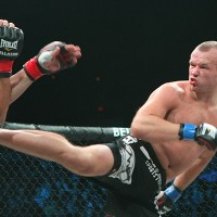 Shlemenko (R) delivers a spinning back kick (Keith Mills/Sherdog)