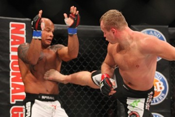 Alexander Shlemenko (R) delivers a kick (Keith Mills/Sherdog)