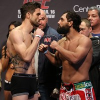 Carlos Condit (L) faces off with Johny Hendricks (Dave Mandel/Sherdog)