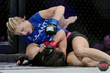 Cassie Rodish (blue top) delivers shots from side control (Jerry Chavez/The MMA Corner)
