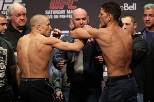 Georges St-Pierre(L) faces off with Nick Diaz (Dave Mandel/Sherdog)