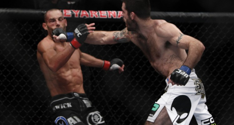 Matt Brown (R) connects with a punch (Esther Lin/MMA Fighting)