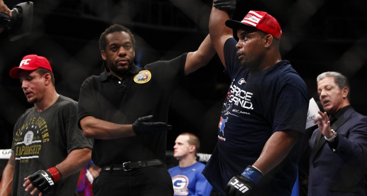 Daniel Cormier has his hand raised in victory (Esther Lin/MMA Fighting)