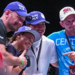 Michelle Waterson poses with her team after capturing the Invicta 105-pound title (Jeff Vulgamore/The MMA Corner)