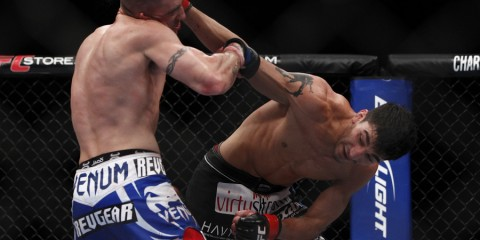 Nijem (R) throws a right hand (Esther Lin/MMA Fighting)