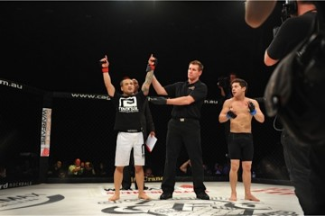 Pham (L) has his arm raised in victory (Chris dela Cruz/Sherdog)