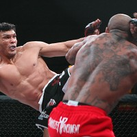 Luis Santos (L) throws a head kick (Keith Mills/Sherdog)