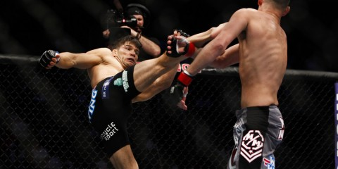 Josh Thomson (L) throws a head kick (Esther Lin/MMA Fighting)