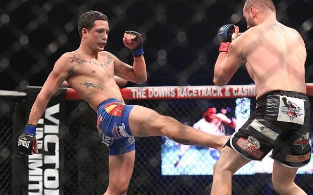 Birchak (L) throws a kick (Wilson Fox/Sherdog)