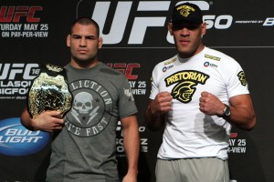 "Cain Velasquez (L) stands with Antonio ""Bigfoot"" Silva (E. Casey Leydon/MMA Fighting)"