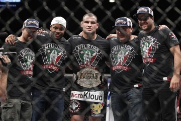 Cain Velasquez (center) poses with his team (Esther Lin/MMA Fighting)
