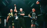 Robert Whittaker (L) has his hand raised in victory (Louie Abigail/Sherdog)