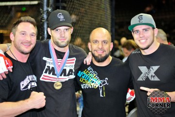 Adam Stroup (second from left) poses with his team (Phil Lambert/The MMA Corner)